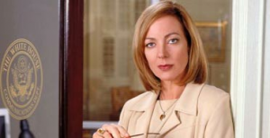 It's Allison Janney!  She was also Mother, on that one episode of Lost that raised more questions than it answered.